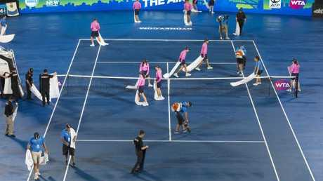 Staff dry the court in Rod Laver Arena. (AAP Image/Craig Golding)