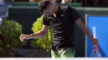 Bernard Tomic reacts after losing a point to Yoshihito Nishioka.