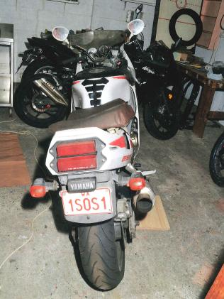 Lilley's motorbike with SOS registration.