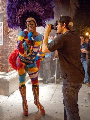 Humans of New York creator Brandon Stanton photographing a subject on the streets. Picture: supplied.