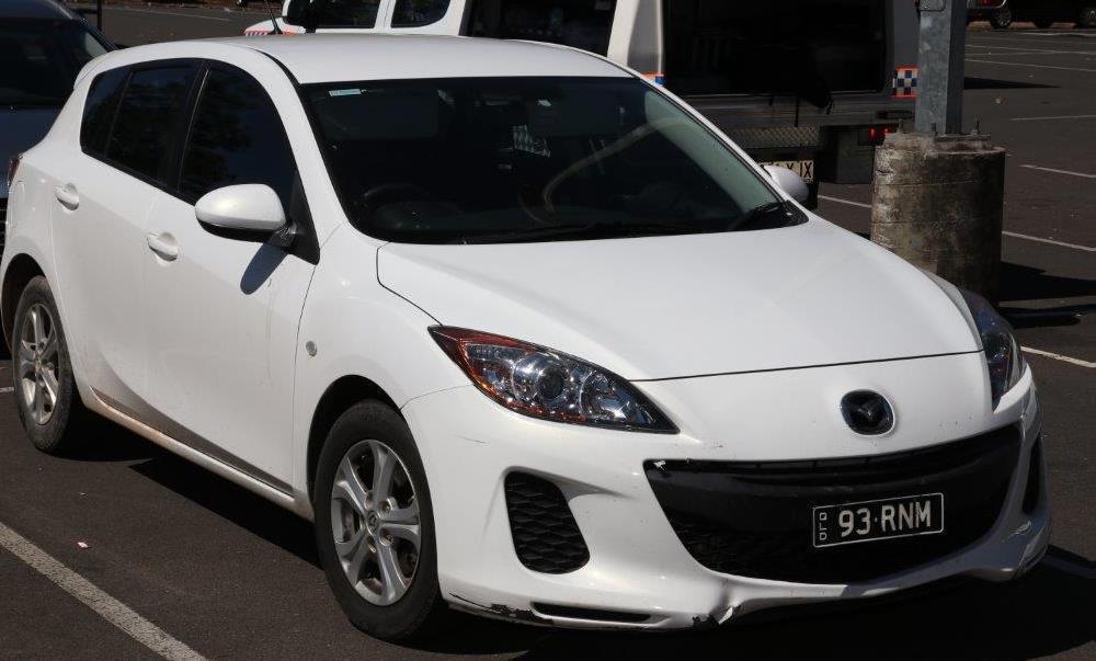 The white Mazda 3.