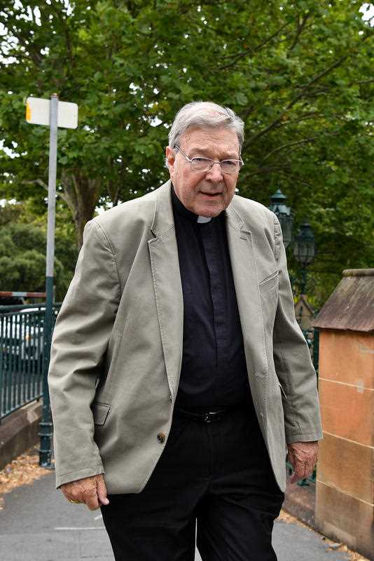 Cardinal George Pell is seen outside St Mary's Cathedral in Sydney, Friday, December 15, 2017.