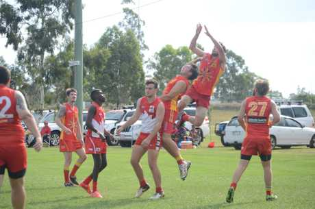 Cam Percival flying high as he seeks a mark for the Suns.