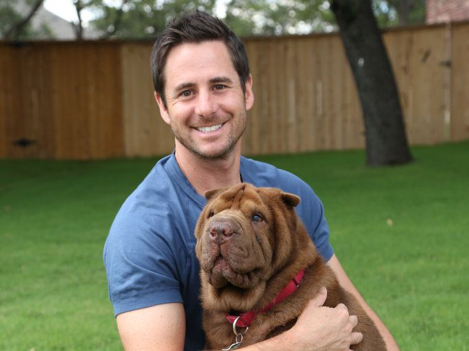 My Big Fat Pet Makeover host Travis Brorsen pictured with the Fillmore family dog Niko.