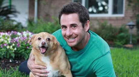My Big Fat Pet Makeover host Travis Brorsen with Lisa and Madison Engels' dog Gracie.