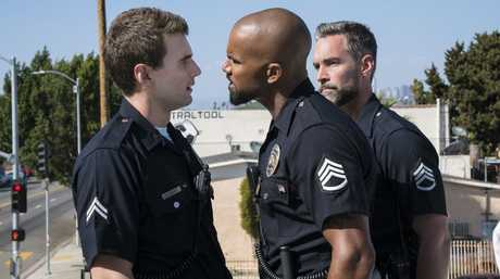 Alex Russell and Shemar Moore in a scene from S.W.A.T.