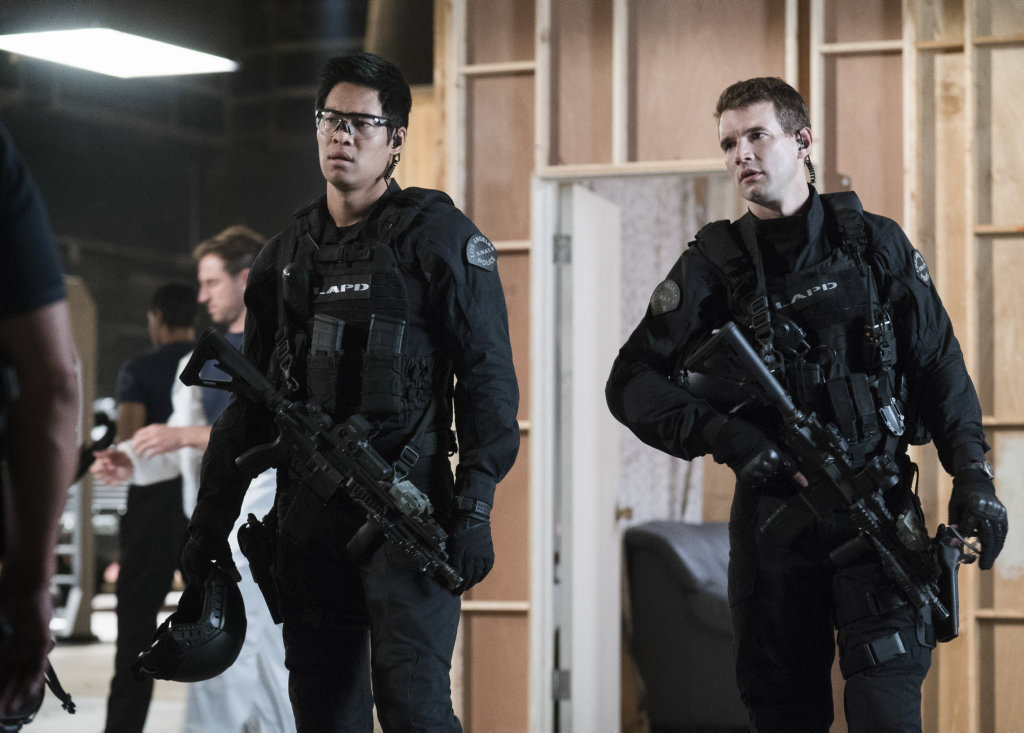 Alex Russell, right, in a scene from S.W.A.T.
