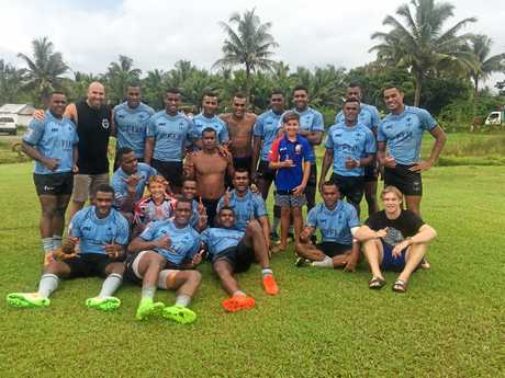 SUPERSTARS: The Costigans during a chance meeting with the Fiji Rugby Sevens national side.
