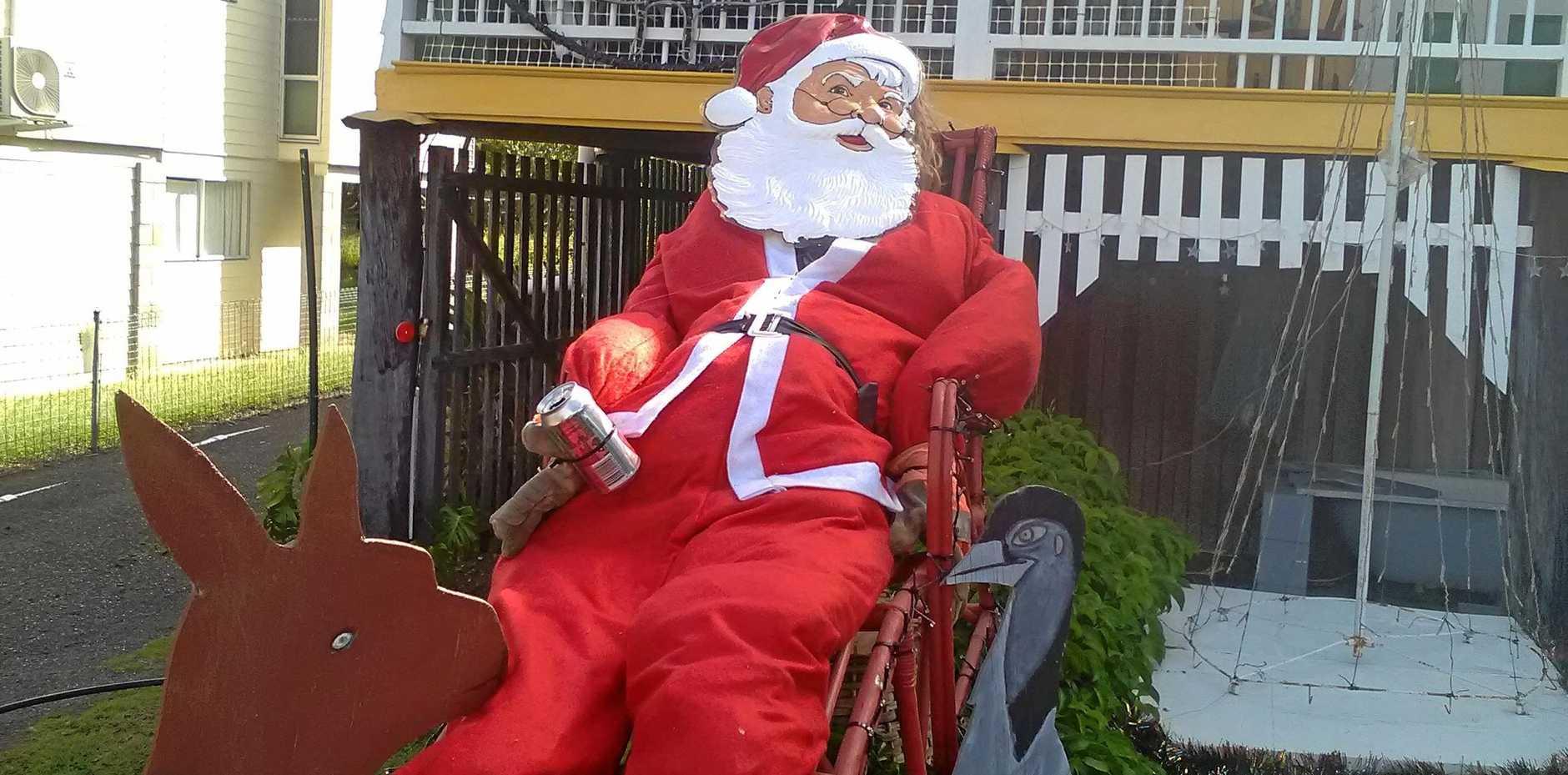 IN THE SPIRT: Stradmann Painters had Santa enjoying a coke in their winning Christmas lights display at Biggenden.