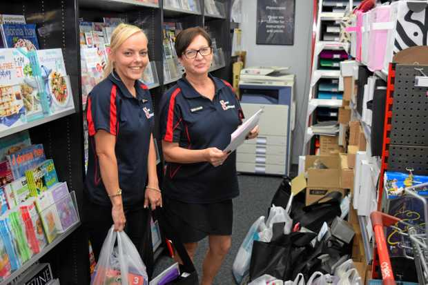 SCHOOL SUPPLIES: Renae Gardiner and Wendy Rossow packing orders at News Whitsunday.