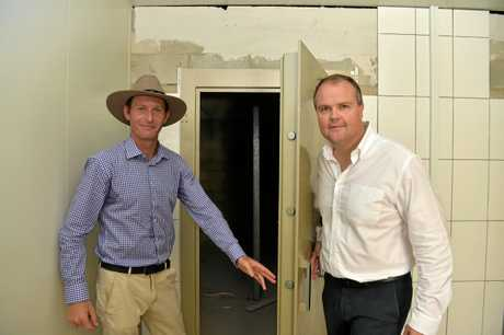 MediFarm Director Adam Benjamin (L) with Member for Fairfax Ted O'Brien in the vault area at the MediFarm secret facility where the final cannabis oil product will be stored.