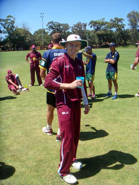 Gladstone's Sam Lowry has a drink while on Queensland Country duty at the 2018 Australian Country Cricket Championships in Geraldton.