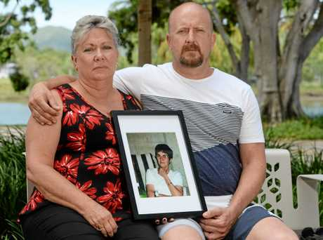L-R Niece Kerry Rothery and son Mick Valigura with a framed photo of Janice Valigura nee Rothery who was allegedly placed in a pine coffin by a funeral director after the family had purchased an expensive casket.
