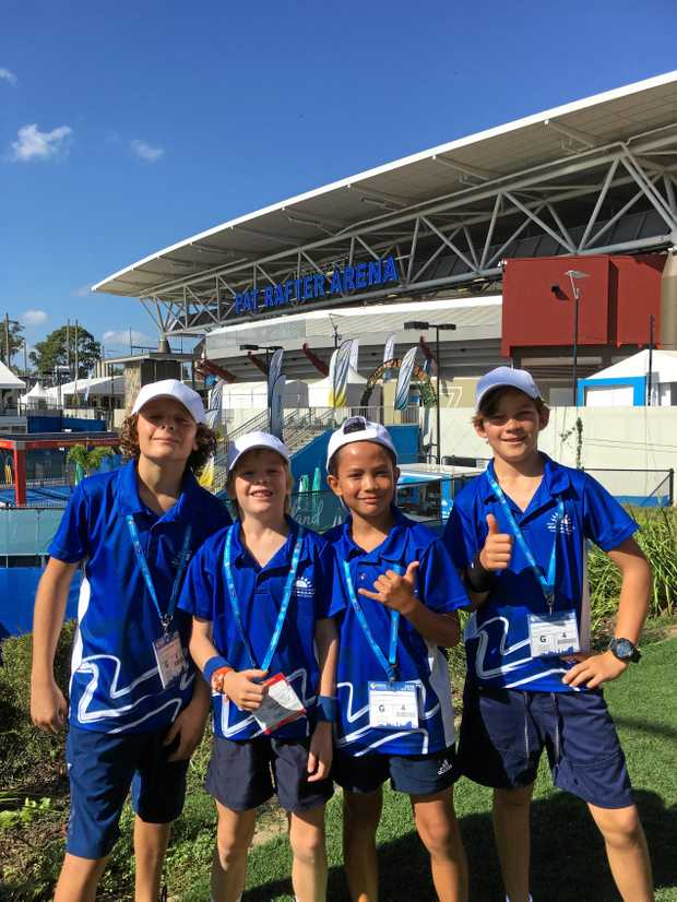 Agnes Water State School students Laef Rupp, Edison Rodgers, Marc Lumagbas-Smith and Ari McCollum posing in front of the Pat Rafter Arena.