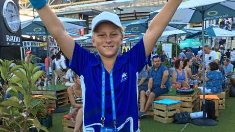 Agnes Water State School student Maxi Wood stands tall in front of Pat Rafter Arena in Brisbane.