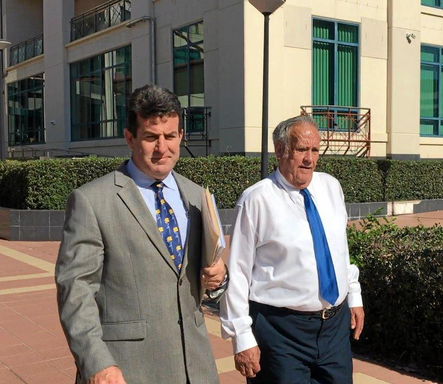 Defence lawyer Brian McGowran and accused child sex offender Kevin Leslie Baker leave Rockhampton courthouse last year.
