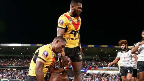 Watson Boas and Kato Ottio celebrate a PNG Test victory over Fiji.