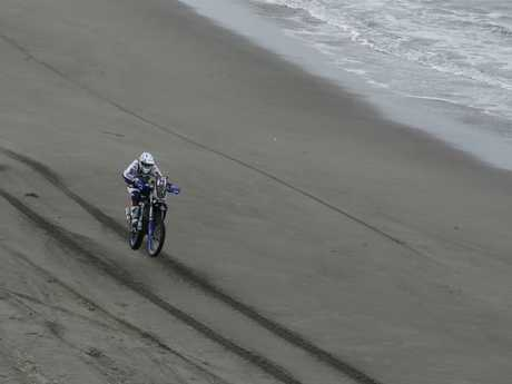 Xavier De Soultrait rides along the beach during Stage 4.