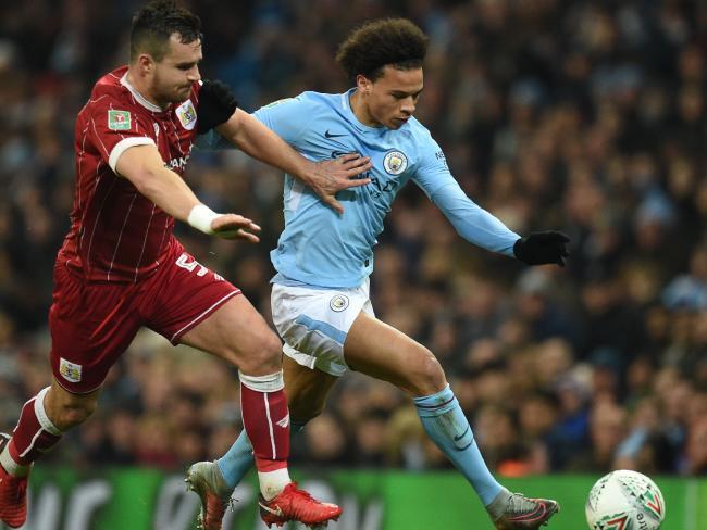Manchester City's German midfielder Leroy Sane (R) vies with Bristol City's Australian defender Bailey Wright