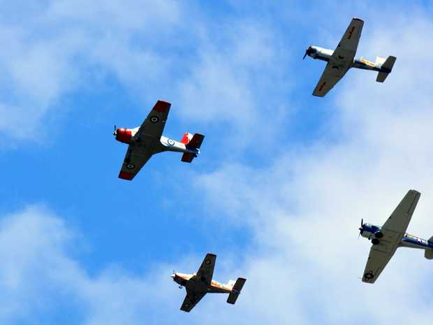A WW11 memorial flypast with a squadron of warbirds pays tribute to the history of Evans Head Aerodrome.