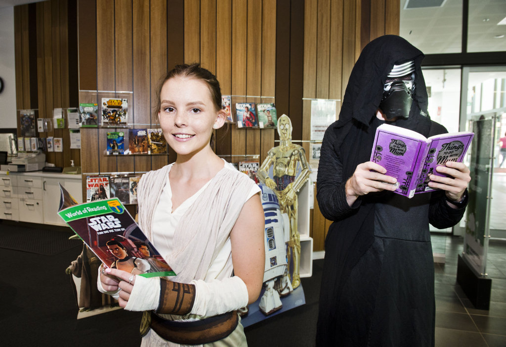 LAST JEDI: ( From left ) Stef Caldwell and Allan Duffy are ready for Star Wars Day at the Toowoomba City Library . Thursday, 11th Jan, 2018.