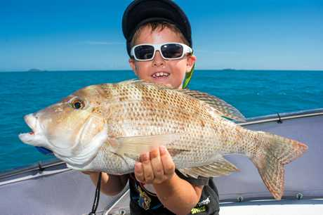 Reef Underwood was rapt at catching this nice sweetlip with his old man Mick.