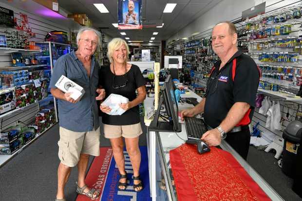 HAPPY CUSTOMERS: Marc and Josephine Tardif De Petiville with salesman Robbie McDuff at JKR Electronics.