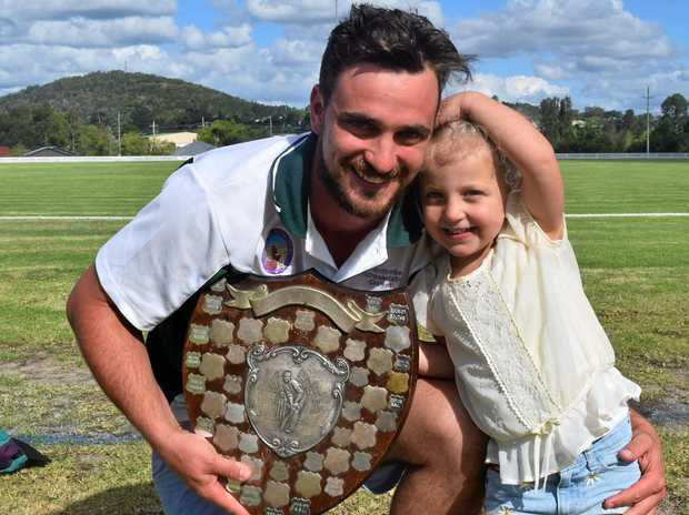 REP RETURN: Ben Staley and daughter Imogen with the Mitchell Shield. Ben will captain Stanthorpe once again in the representative fixtures.