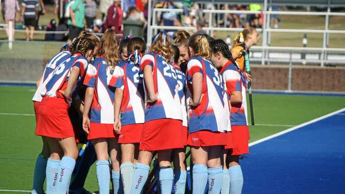 KEEN PLAYERS: The Warwick under-13 hockey team talk tactics.