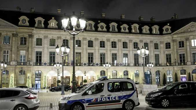 A police car is parked in front of the main entrance of the Ritz following the jewellery robbery.