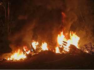 Truck rolls and bursts into flames near Urunga