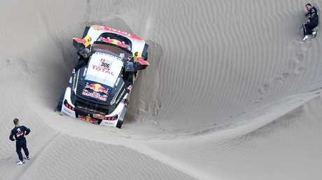 Sebastien Loeb (L) and co-driver Daniel Elena (R) are out of the Dakar Rally.