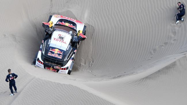 Sebastien Loeb (L) and co-driver Daniel Elena (R) are out of the Dakar Rally.
