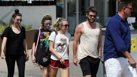 Miley Cyrus, Liam Hemsworth and friends leave Rick Shores restaurant in Burleigh Heads. Picture: Nigel Hallett.