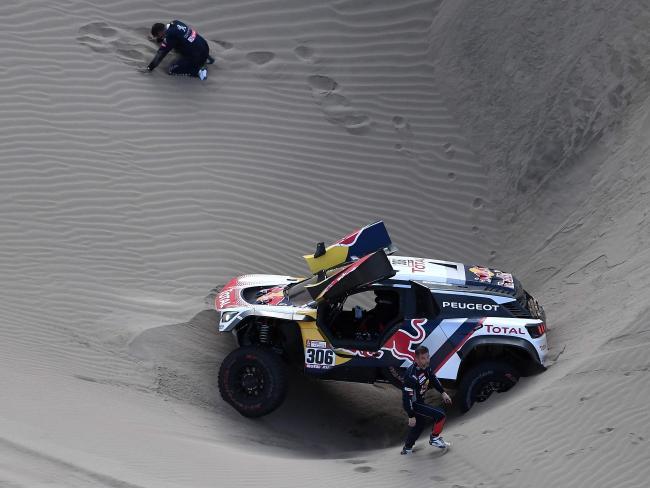 Co-driver Daniel Elena (top) and Sebastien Loeb with their stricken car.