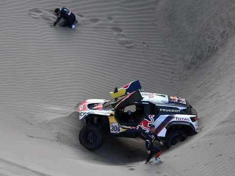 Co-driver Daniel Elena (top) and Sebastien Loeb with their stricken car.