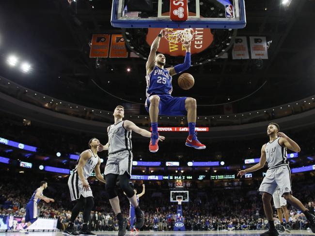 Philadelphia 76ers' Ben Simmons (25) dunks against the San Antonio Spurs.