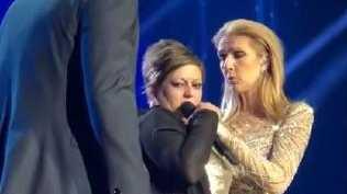 The fan grabbed Celine's microphone.