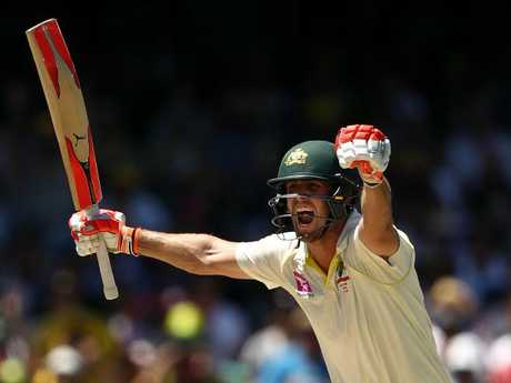 Mitch Marsh celebrates his century in Sydney.