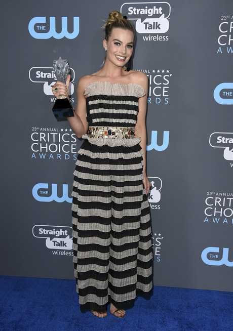 Robbie with her award for Best Actress.
