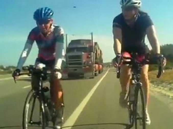 A still from a video in The West Australian showing a truck driving past cyclists.