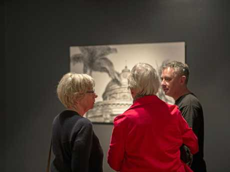 Patrons at Rockhampton Art Gallery view the Bayton Award finalists' works, including Erin Dunne's drawing (in the background) of Rockhampton's Custom House.