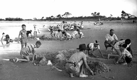 Children from a camp at Alexandra Park Presbyterian Conference property play on the beach in January 1960.