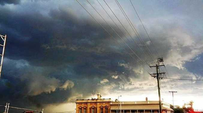 Katrina M Hall: Storm over Gympie.