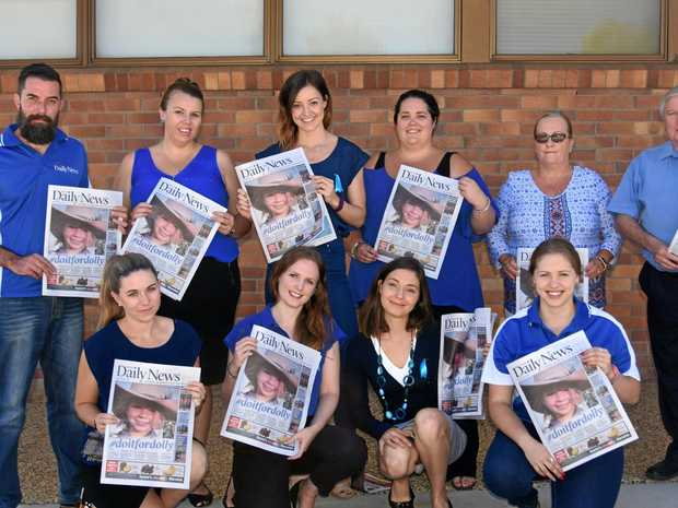 FOR DOLLY: The Warwick Daily News show their support for #doitfordolly (back, from left) Jonno Colfs, Lisa Bergemann, Georja Ryan, Kaela Freeman, Donna Hey, Glyn Rees, (front) Lara Brackin, Elyse Wurm, Marian Faa and Tracey Madsen.