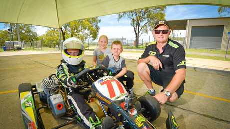Zac Bell with Quaid, 8 Elli, 10 and Stephen Bell at the Gladstone Kart track.
