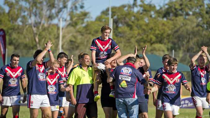 GLORY: Calliope Roosters celebrate after defeating Wallaby's in the 2016 grand final.