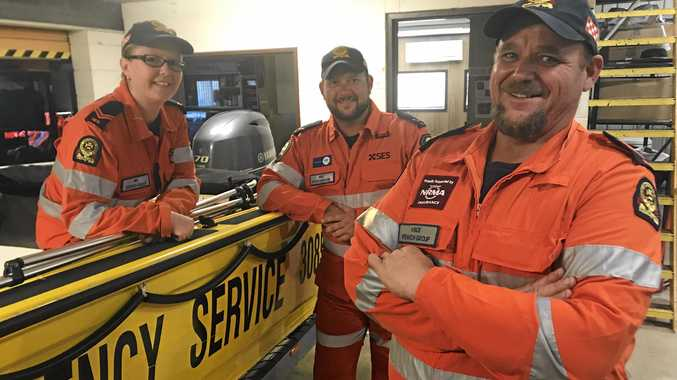 READY: Ipswich SES members Mel Lindwood, Nick Steinhardt and Vince McGuire with the floodboat.