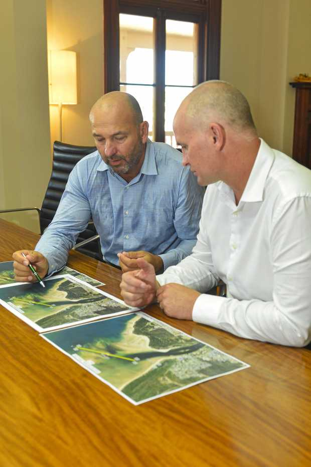 READY: Member for Gladstone Glenn Butcher and Gladstone Ports Corporation acting CEO Craig Walker examine plans for the Boyne River dredging work.