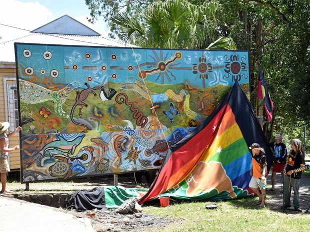 The unveiling of the mural painted by Indigenous artists Oral Roberts, Lewis Walker and Gilbert Laurie.